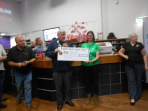 Cheque being presented to the charity ELF