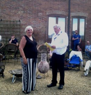 Lion Carol Wells,handing over to new Lion President Mike Mitchell