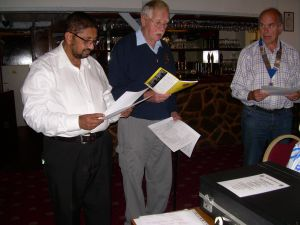 Lion Clif Cane reading out the Lions Code of Ethics to prospective member James Balasundaran,with Lion president Martin Fairley