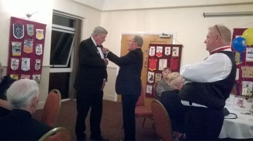 Lion Mike Mitchell receiving his Melvin Jones Fellowship Badge from DG Elect Peter Rowe