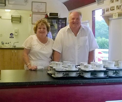 Lion Sue Bates and husband Steve at serving bar in railway cafe coach