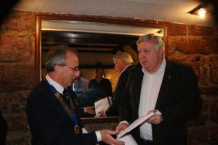 Lion President Twiggy Lake welcoming Lion Mike Mitchell to the Club